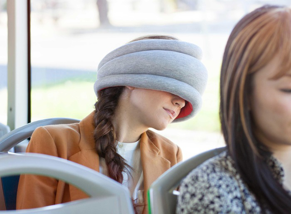 Ostrich Pillow Light is a tubular pillow that enables power napping